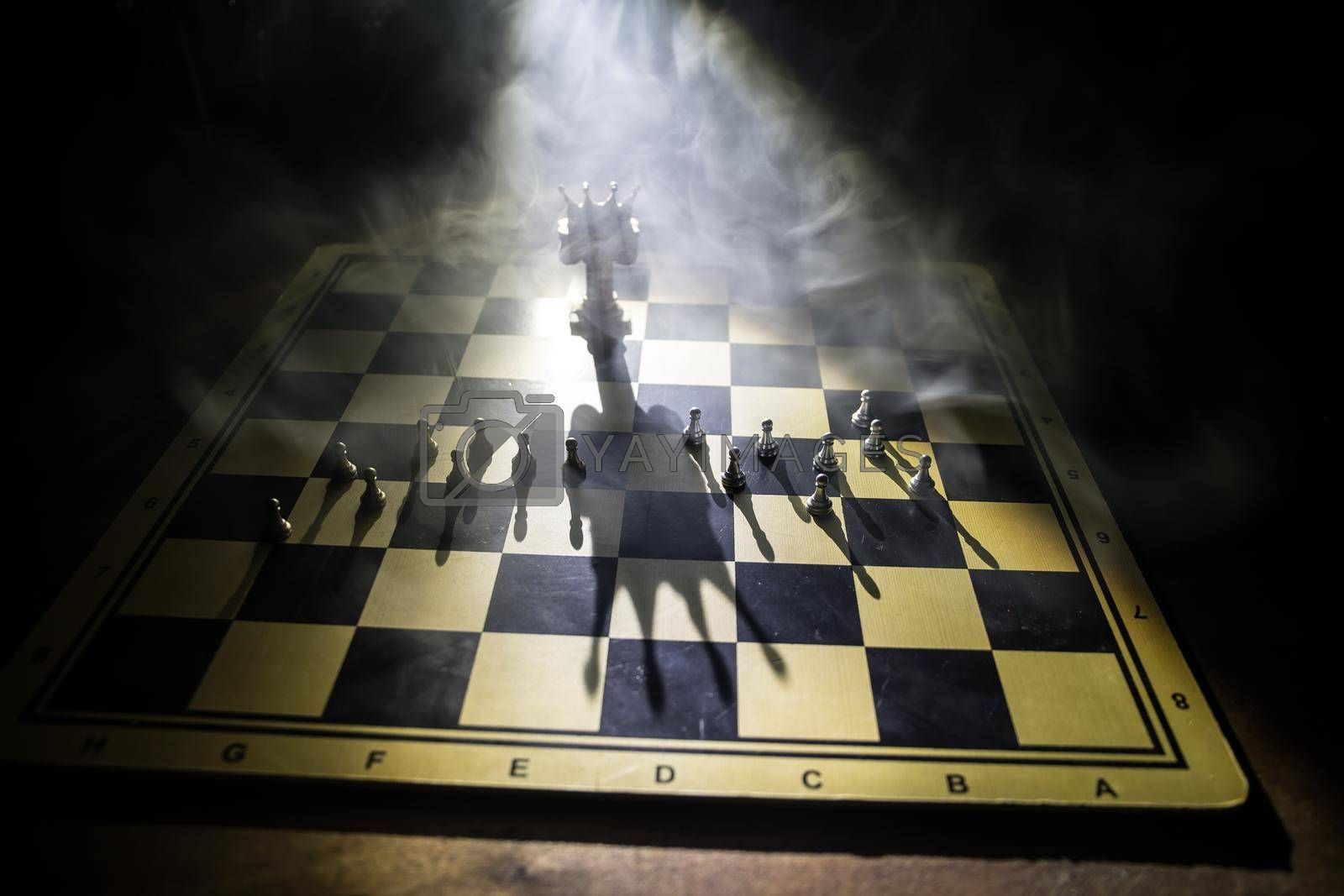 Beautiful crown miniature on chessboard. chess board game concept of business ideas and competition and strategy ideas concept. Chess figures on a dark background with smoke and fog. Selective focus