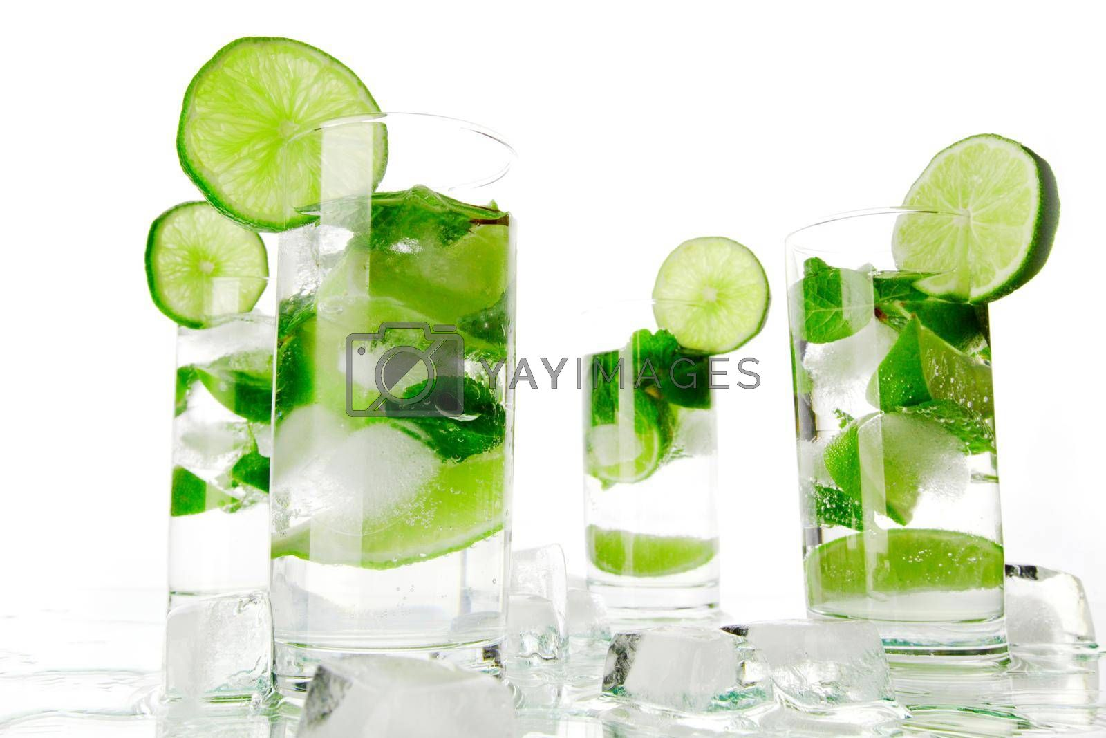 Mojito cocktails with lime and mint isolated on white background