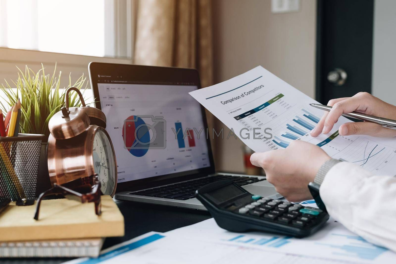 Business woman working with financial data hand using calculator for analysis financial data, Business financial and accounting concept. by wichayada