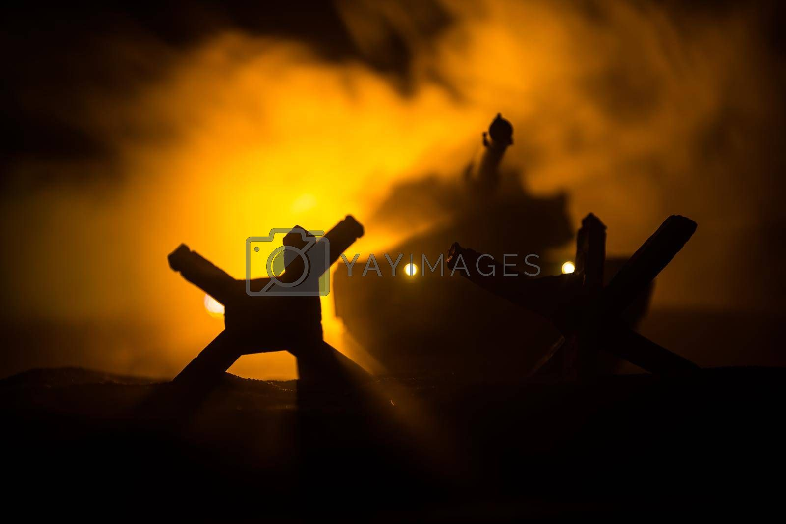 Royalty free image of War Concept. Armored vehicle silhouette fighting scene on war foggy sky background at night. American tank ready to fight. by Zeferli