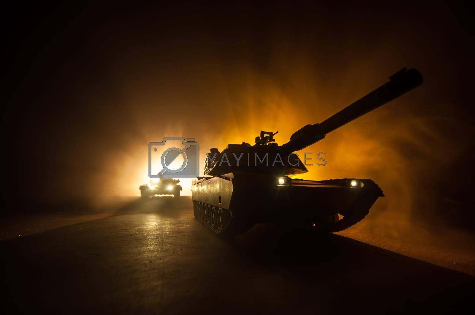 War Concept. Armored vehicle silhouette fighting scene on war foggy sky background at night. American tank ready to fight. by Zeferli