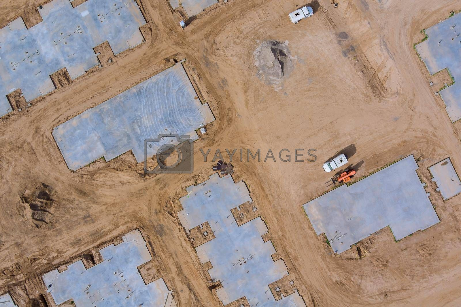 Aerial view on construction work in newly completed cement foundation of new residential district with apartment buildings