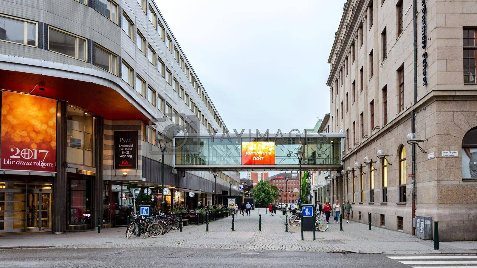 Malmo, Sweden - July 25, 2017:  Panoramic view of Stora Nygatan and Malmborgsgatan Street in the centre of Malmo in Sweden. Malmo is the largest city of Skane County and the third largest city in Sweden after Stockholm and Gothenburg.