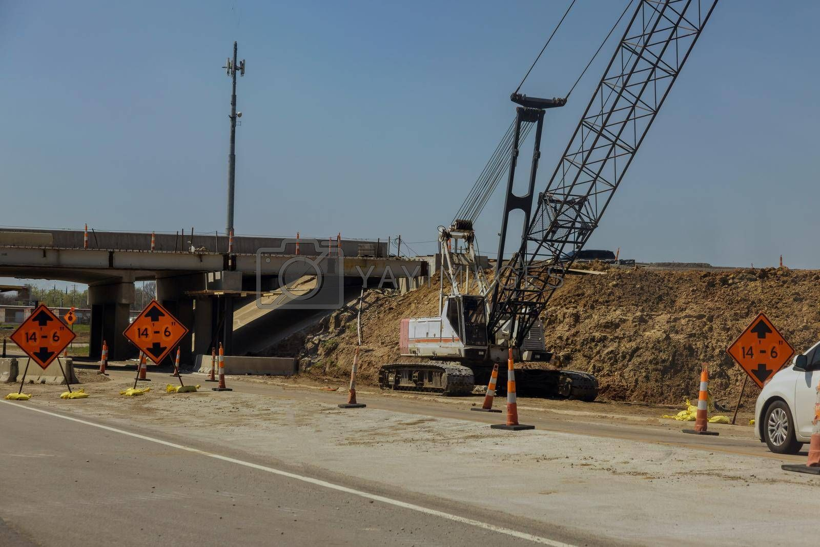 Repair site on the under renovation bridge with road under construction in the USA
