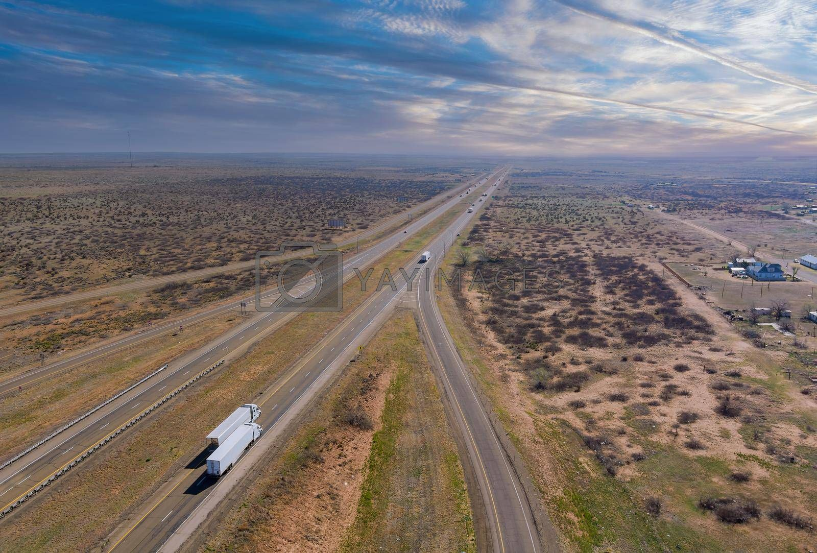 Desert road aerial of a new two lane road surrounded by desert landscape near San Jon New Mexico USA