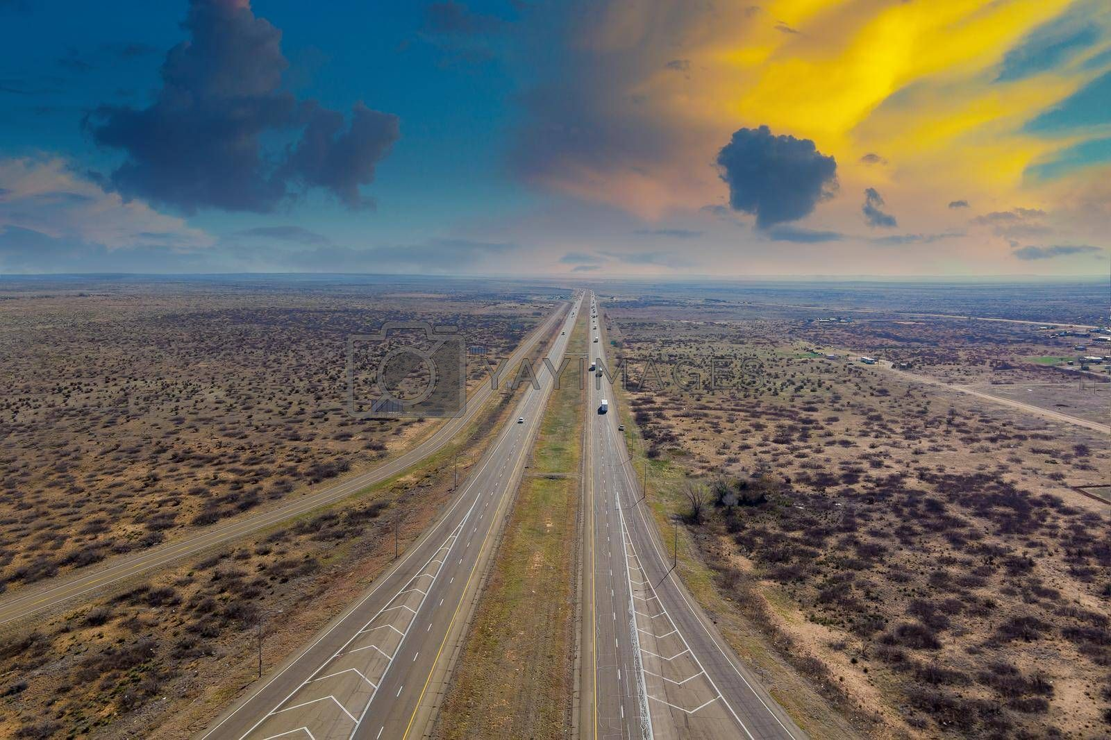 Scenic sunset highway a cargo truck enduring through desert landscape of near San Jon New Mexico USA