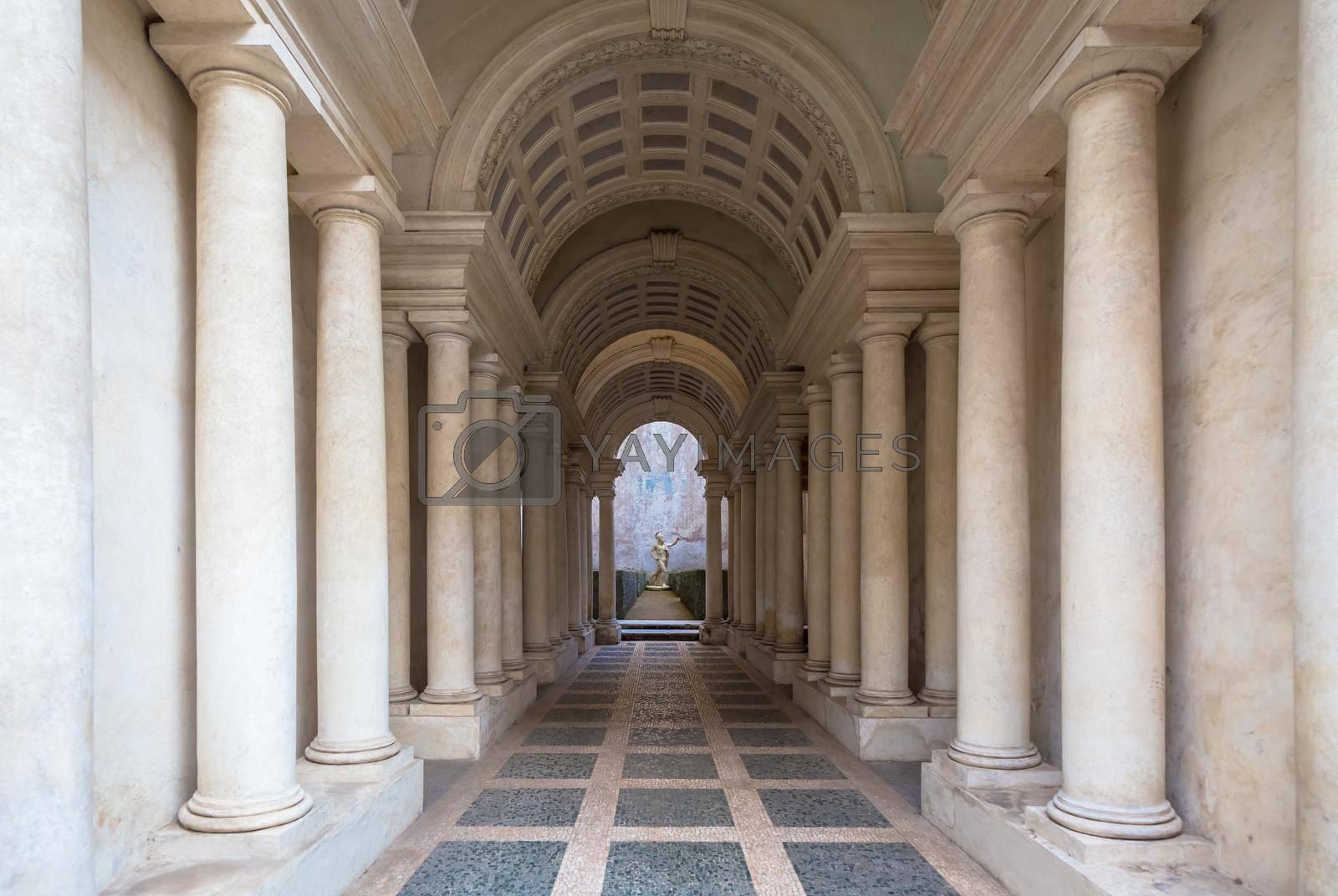 ROME, ITALY - August 23, 2018: Prospettiva Borromini (Borromini Perspective), corridor with marble columns in this luxury palace