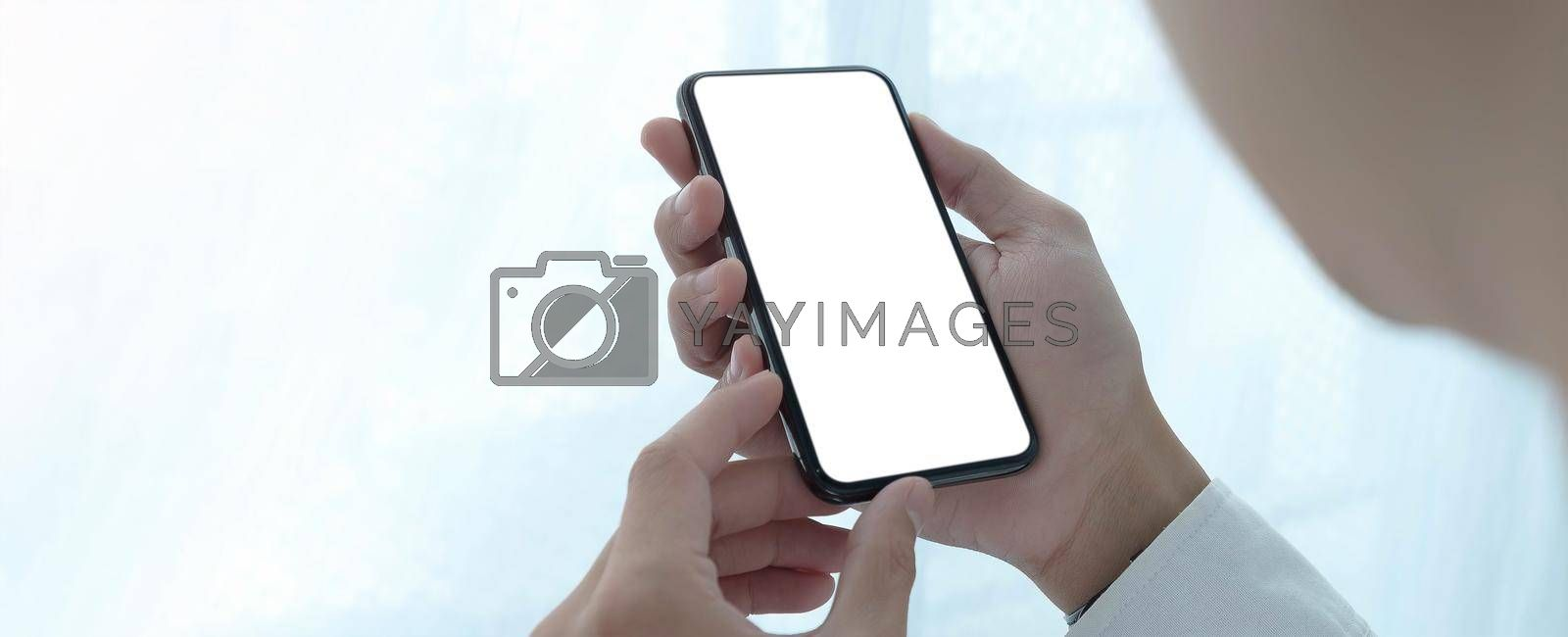 Top view Woman sitting and holding blank screen mock up mobile phone.
