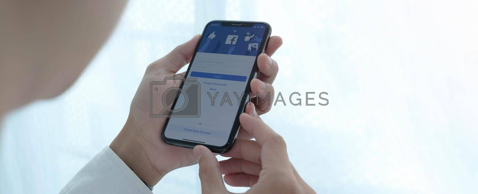 CHIANG MAI, THAILAND, JUL 27, 2020 : Facebook social media app logo on log-in, sign-up registration page on mobile app screen on iPhone smart devices in business person's hand at work.