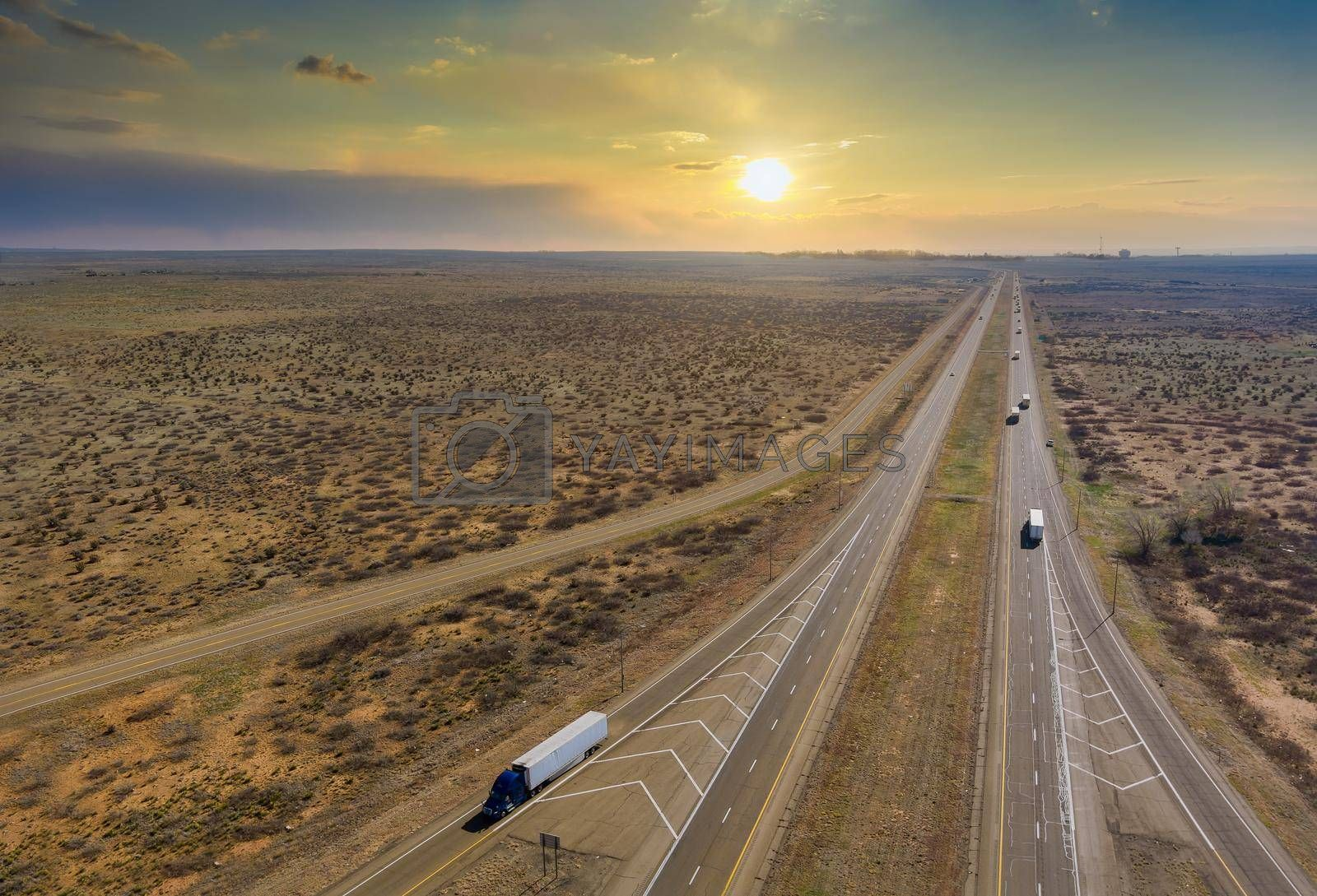Panorama sunset view of highway in America located west in desert environment near San Jon New Mexico USA