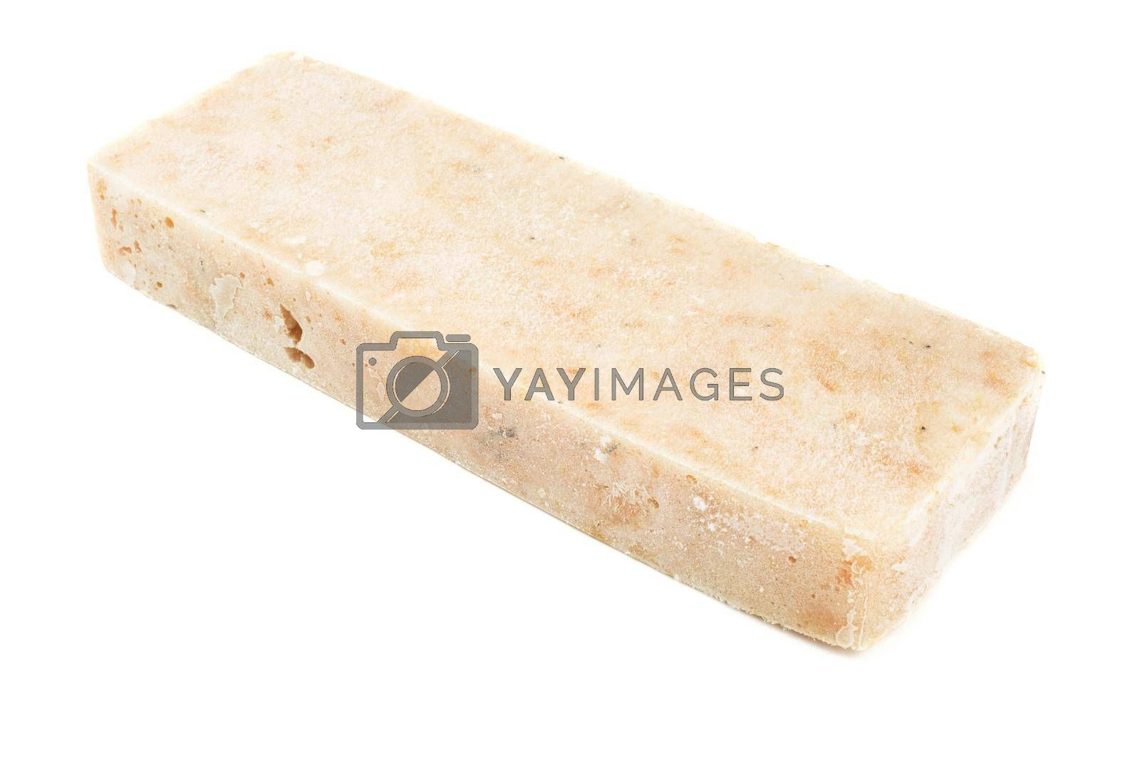 Frozen minced cod fish block isolated on white background, semifinished prepack