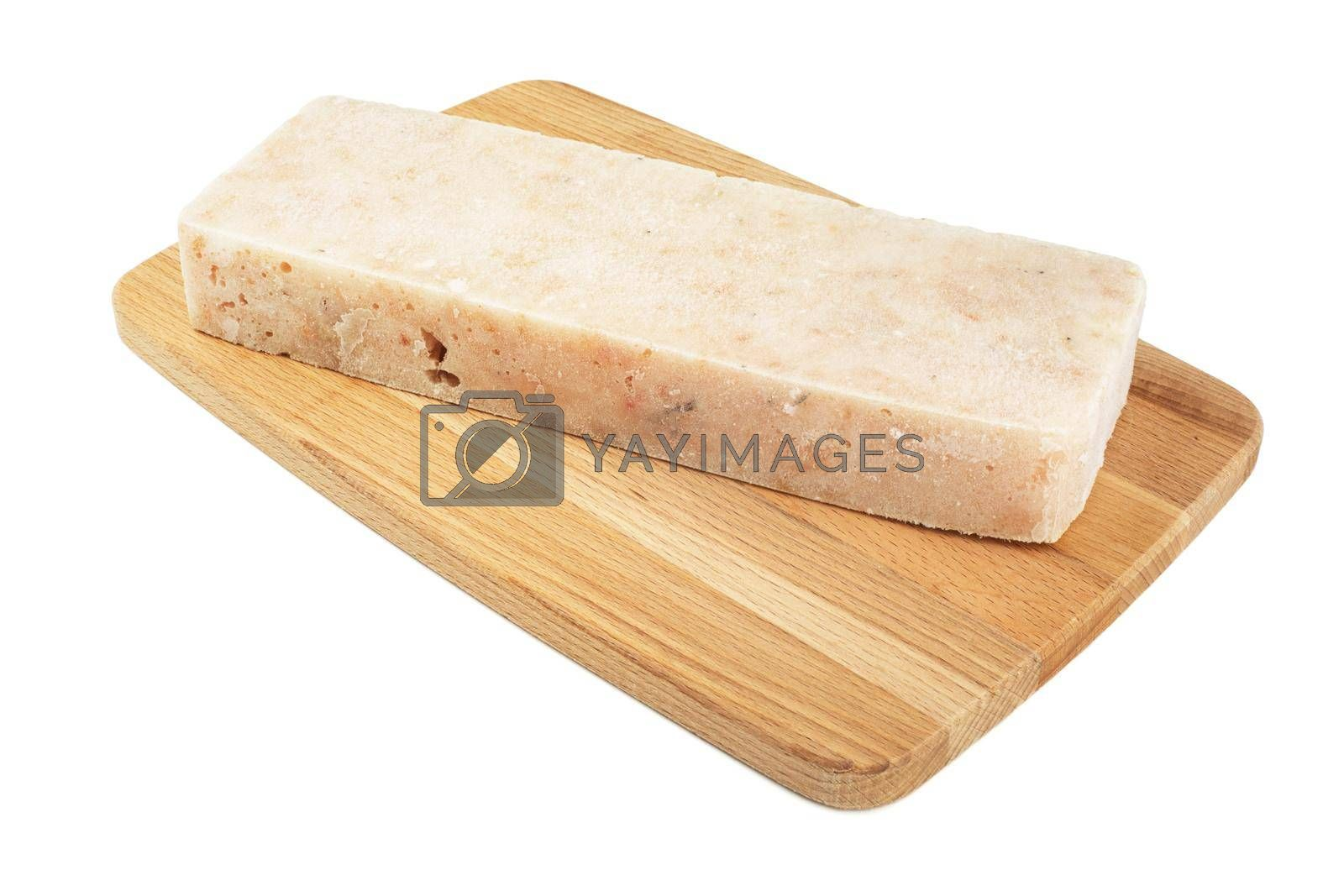 Frozen minced cod fish block on cutting board isolated on white background, semifinished prepack