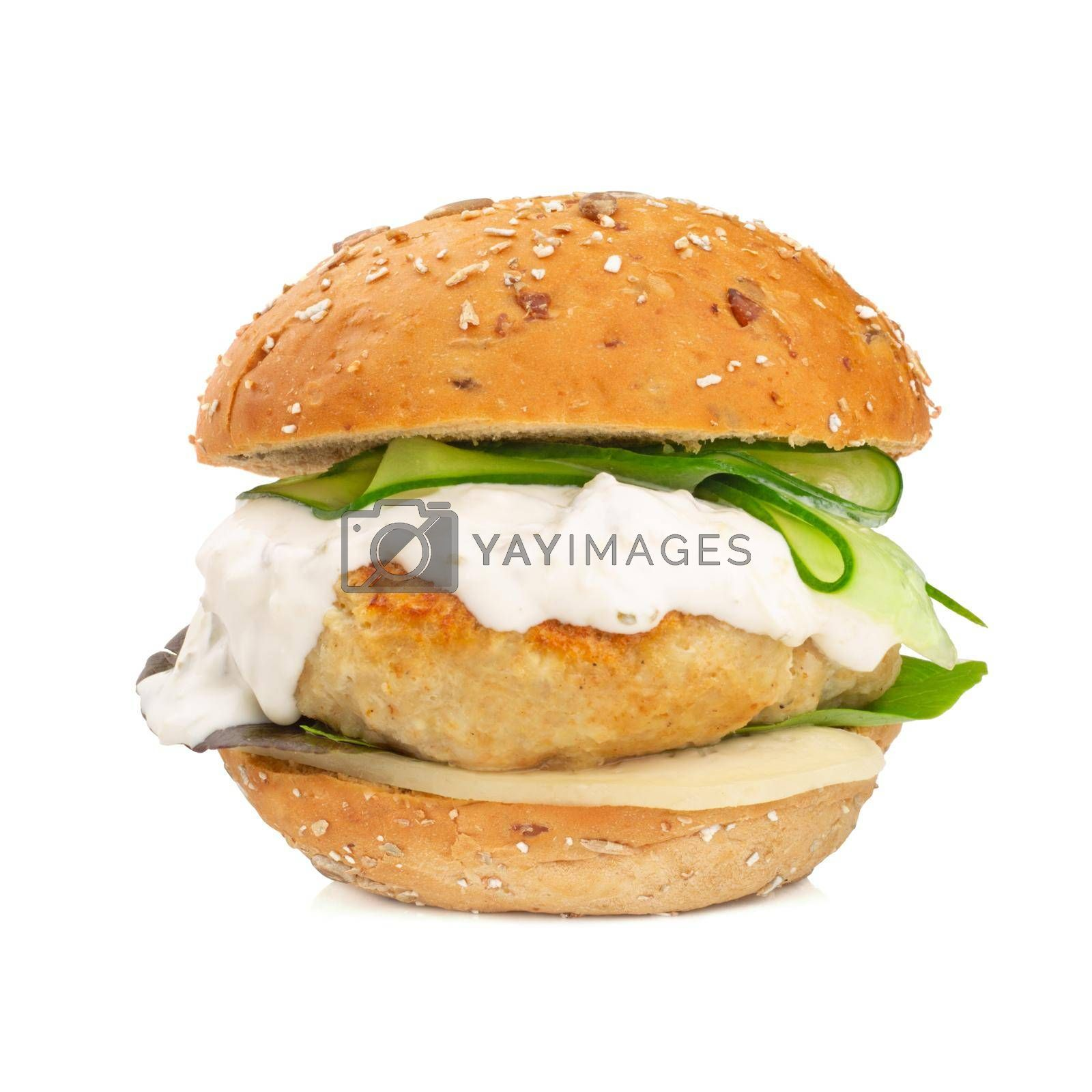 Fishburger fish burger with cod cutlet cucumber lettuce goat cheese dzatziki tartarus sauce and grain cereal bread isolated on white background