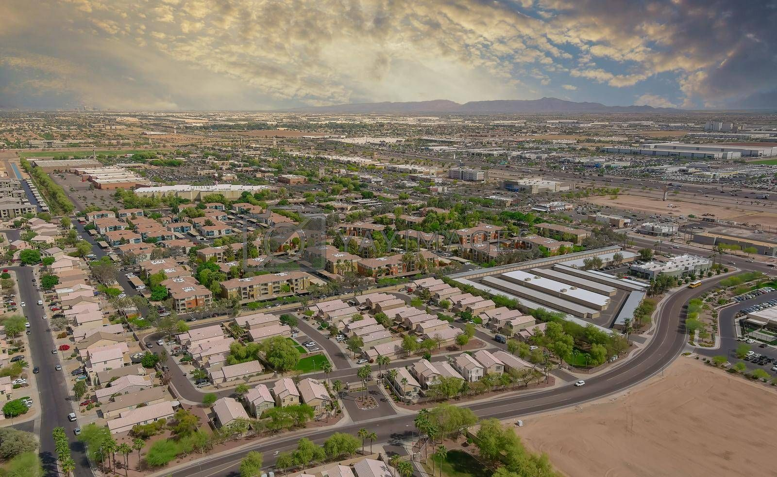 Royalty free image of Aerial view of mixing single family homes, apartment buildings a residential district a Avondale near Phoenix Arizona US by ungvar