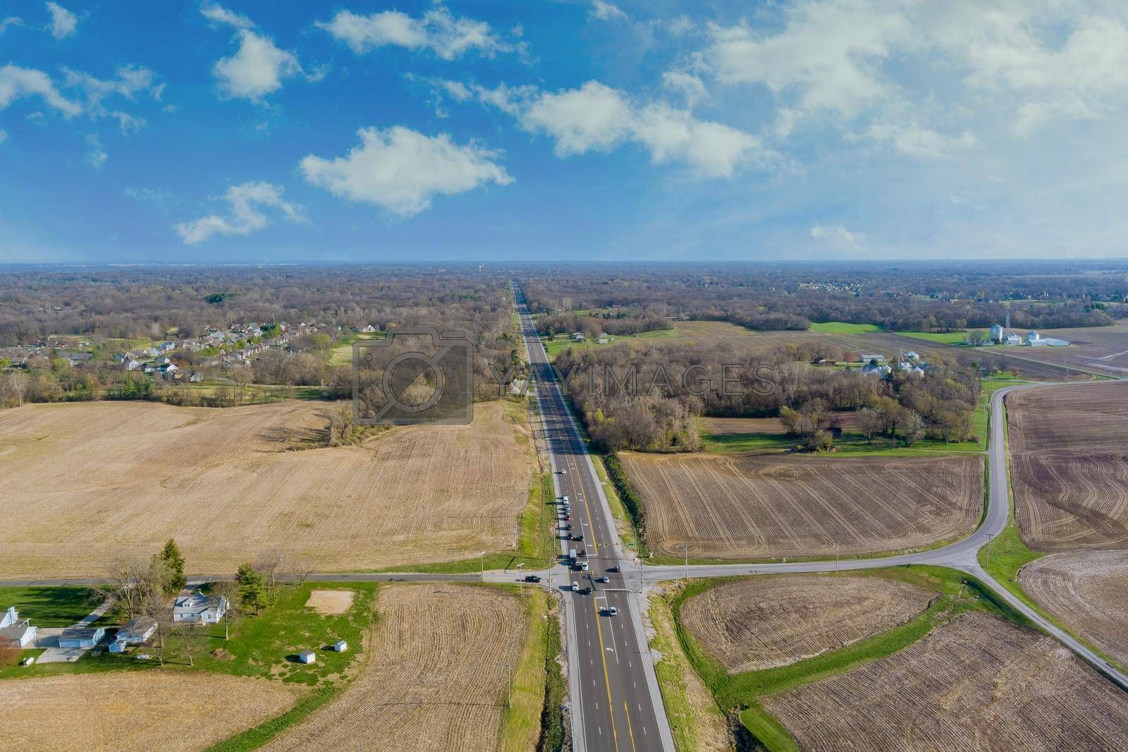 Aerial view of american countryside farmland country asphalt road through landscape the Caseyville Illinois on USA