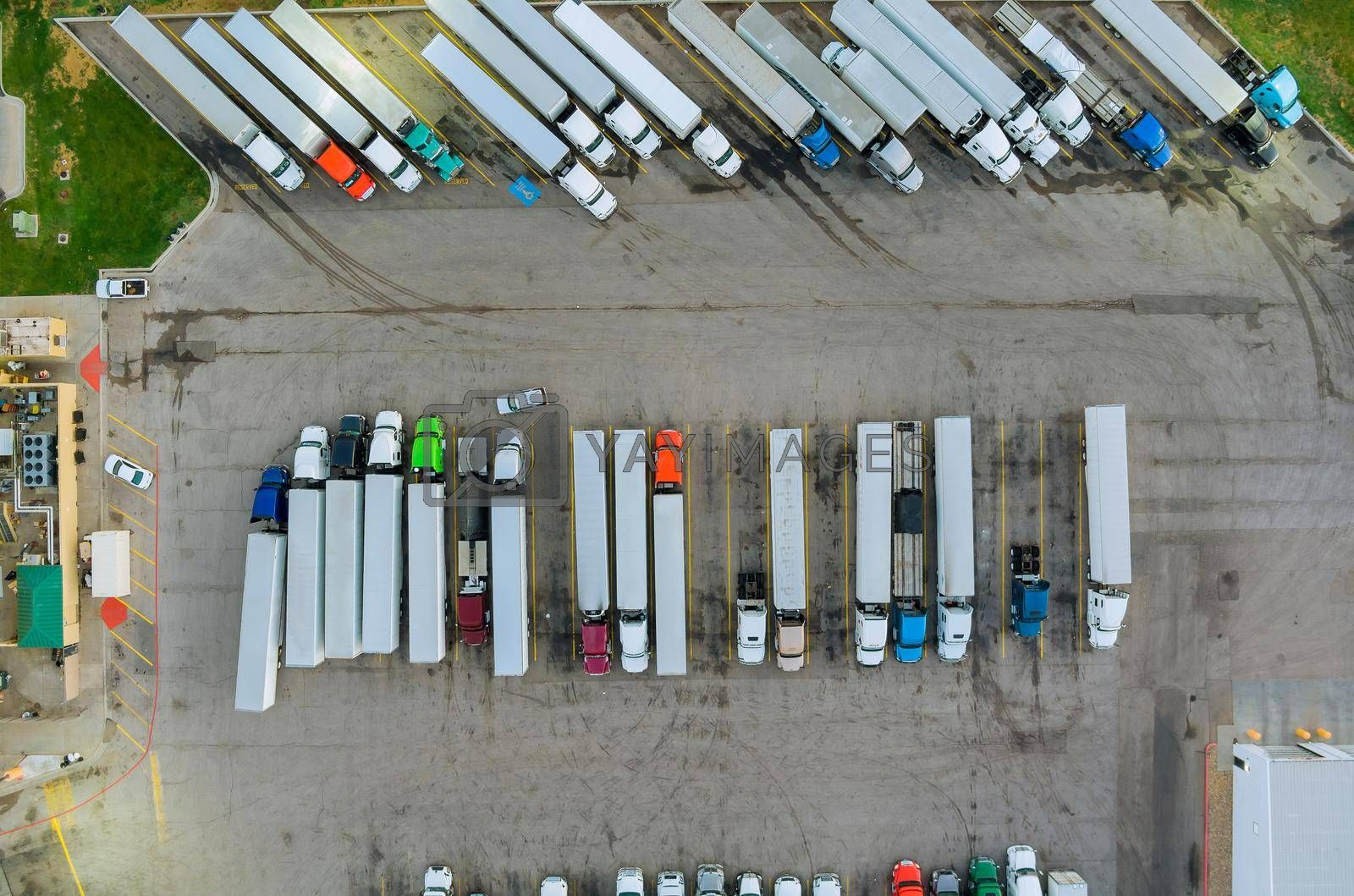 Aerial top view semi truck with cargo trailer car parking of truck rest area dock