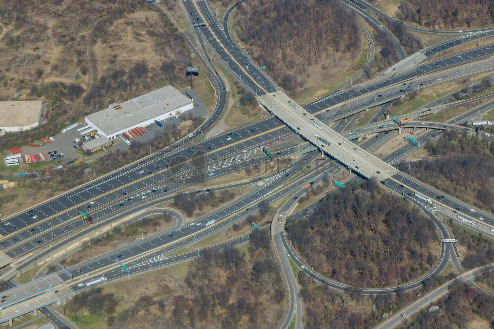 High drone view above highways, interchanges the roads on interstate takes you on a fast transportation highway in Newark New Jersey US