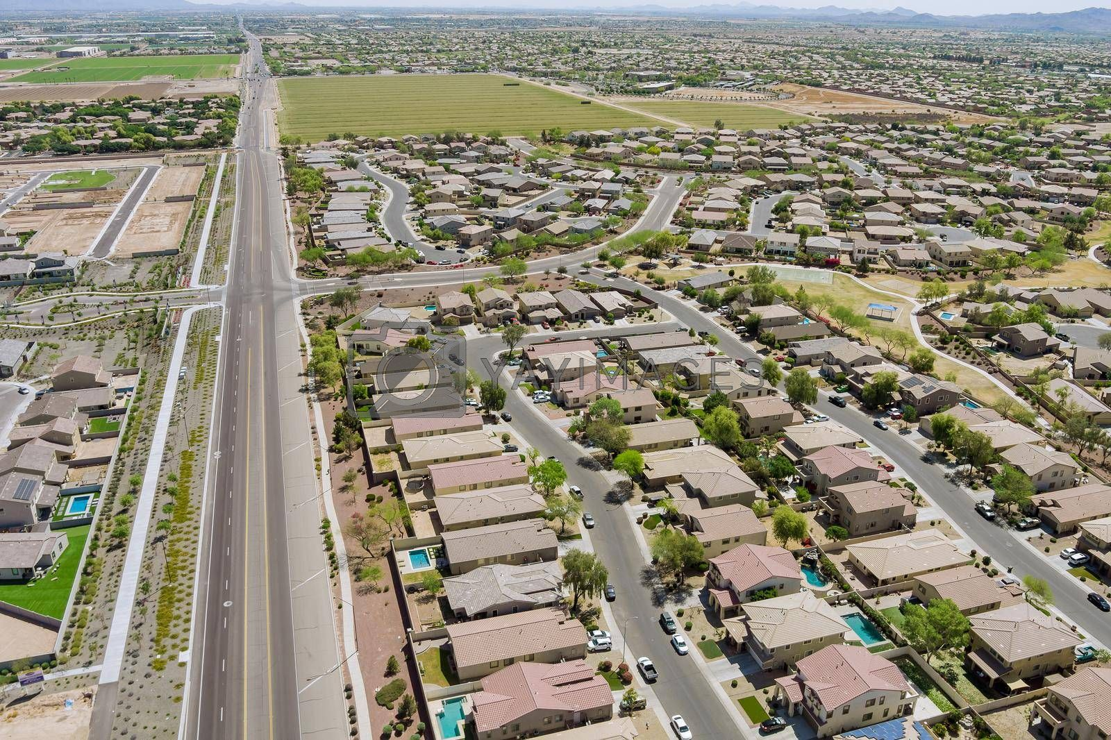 Landscape scenic aerial view of a suburban settlement in USA with detached houses the Avondale town Arizona US