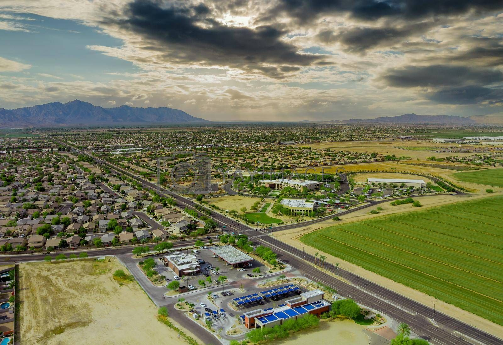 Aerial drone view of small town near mountains area a residential neighborhood with Avondale town Arizona USA