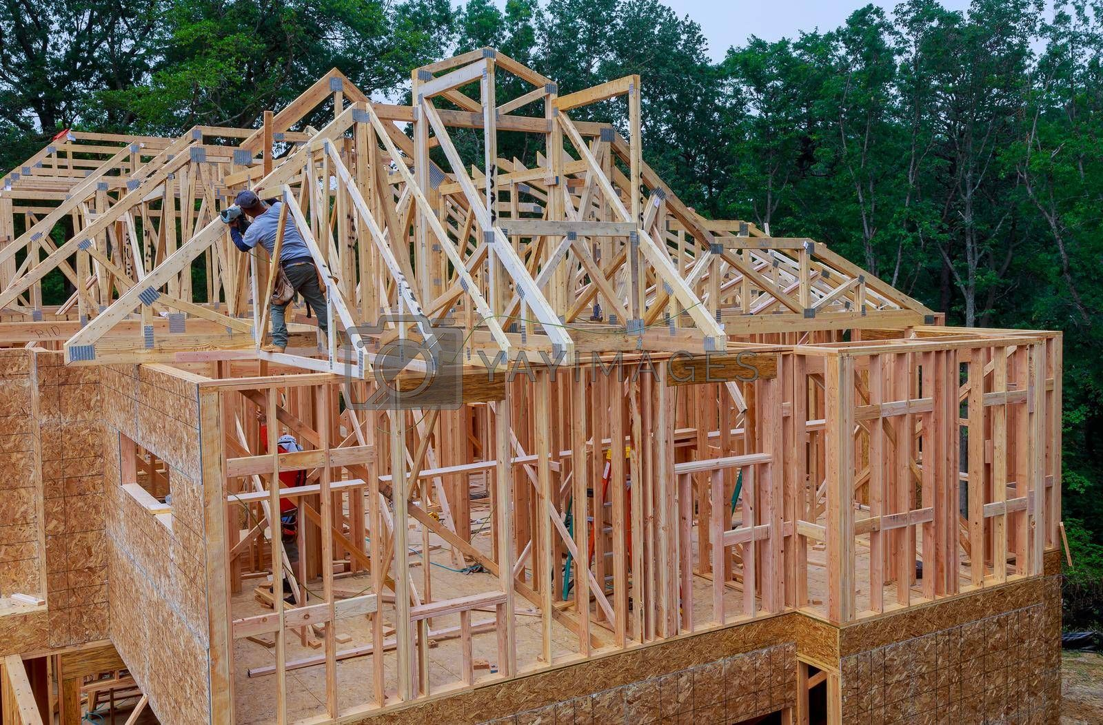 Residential house with wooden frame under construction beams house installation the roof of the house