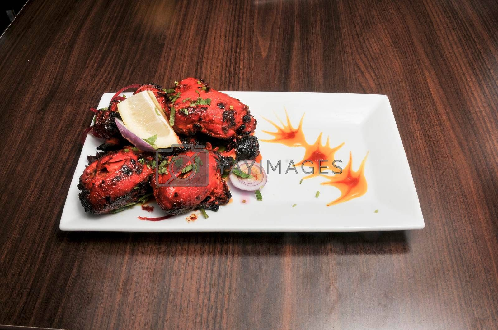 Traditional and authentic indian cuisine known as tandoori chicken