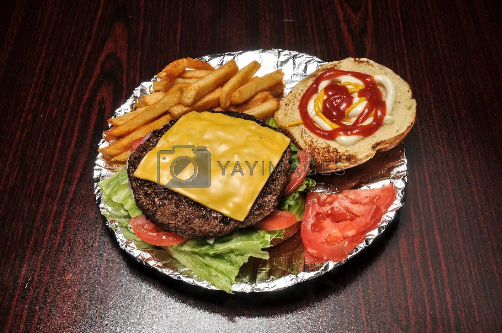 Delicious cheeseburger with all the fixings on a bun