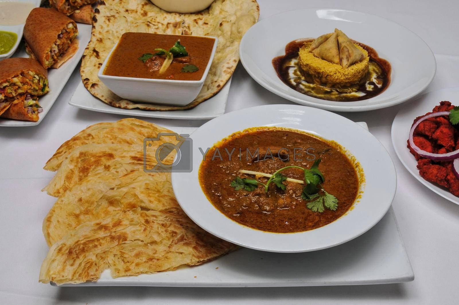 Delicious and authentic cuisine known as Chicken Chettinad Parotta