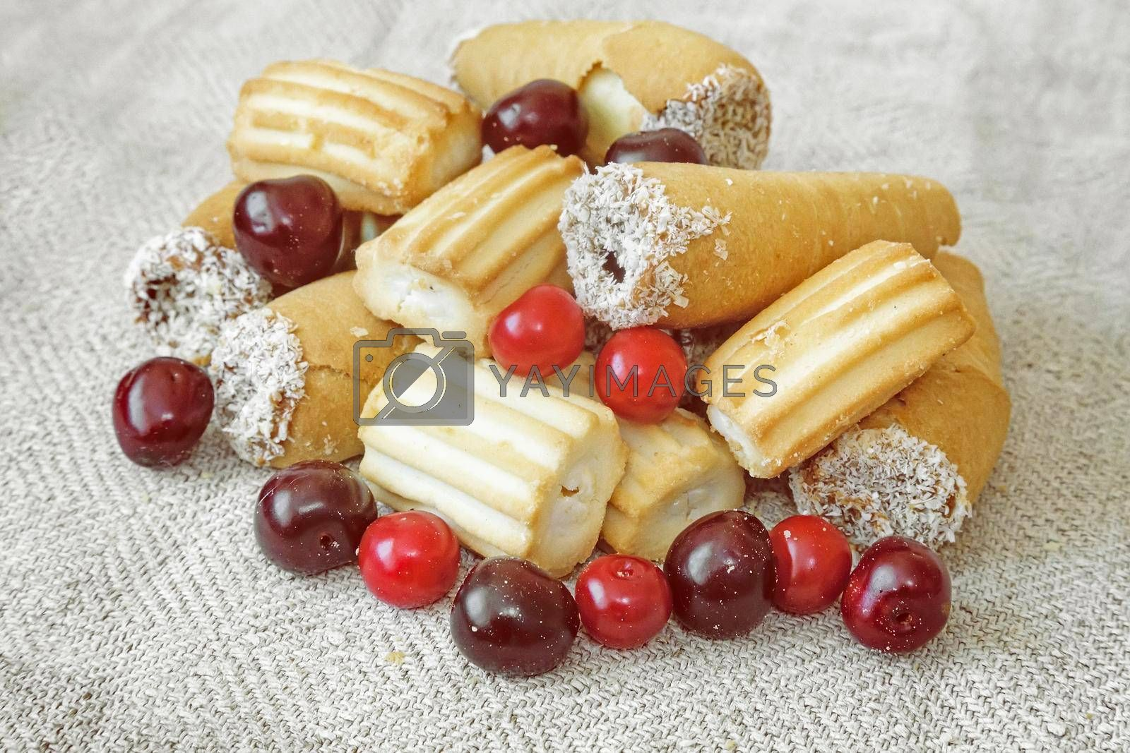 On the napkin on the table biscuits, and cherries.