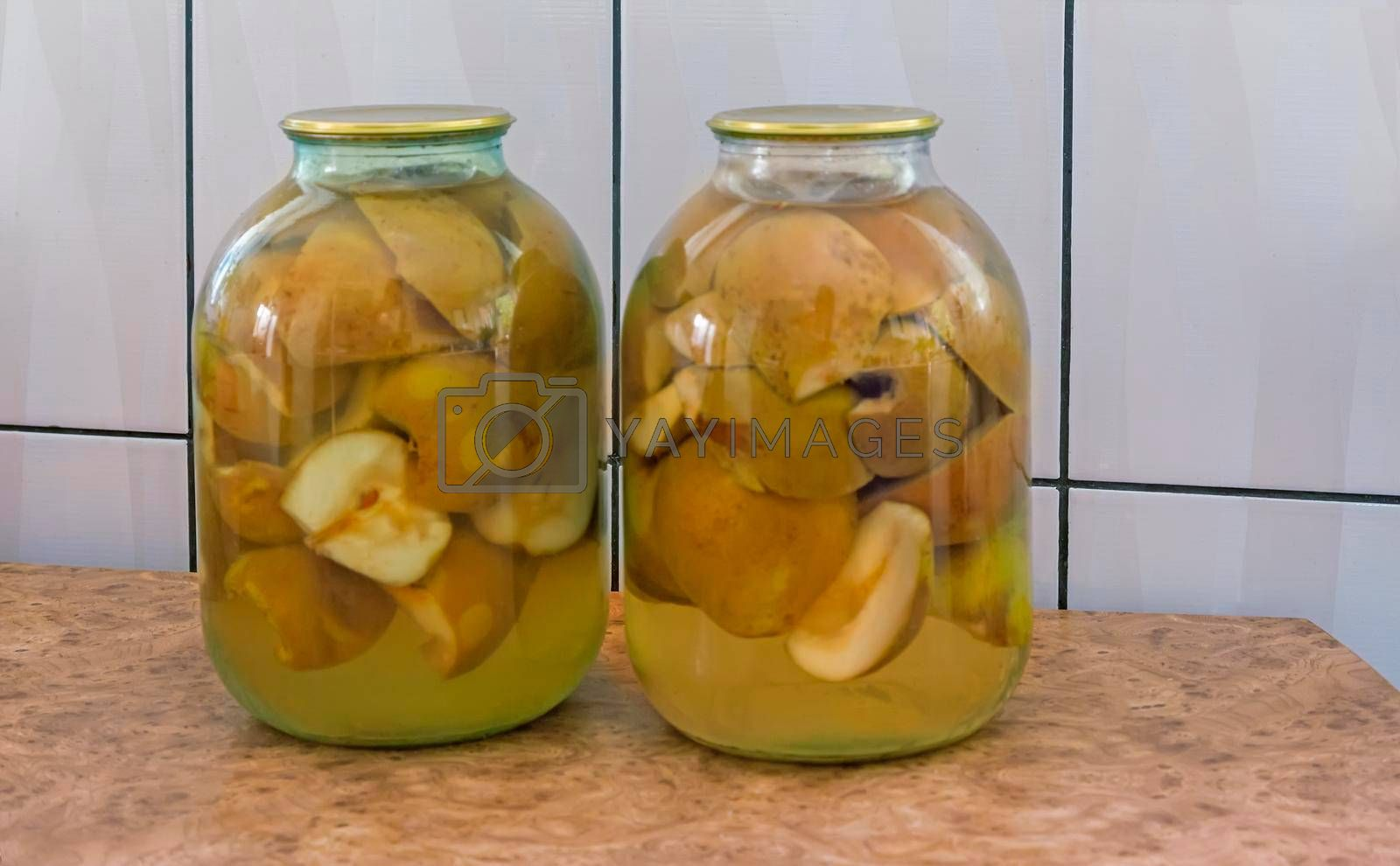 Royalty free image of Canned pear in glass jar. by georgina198