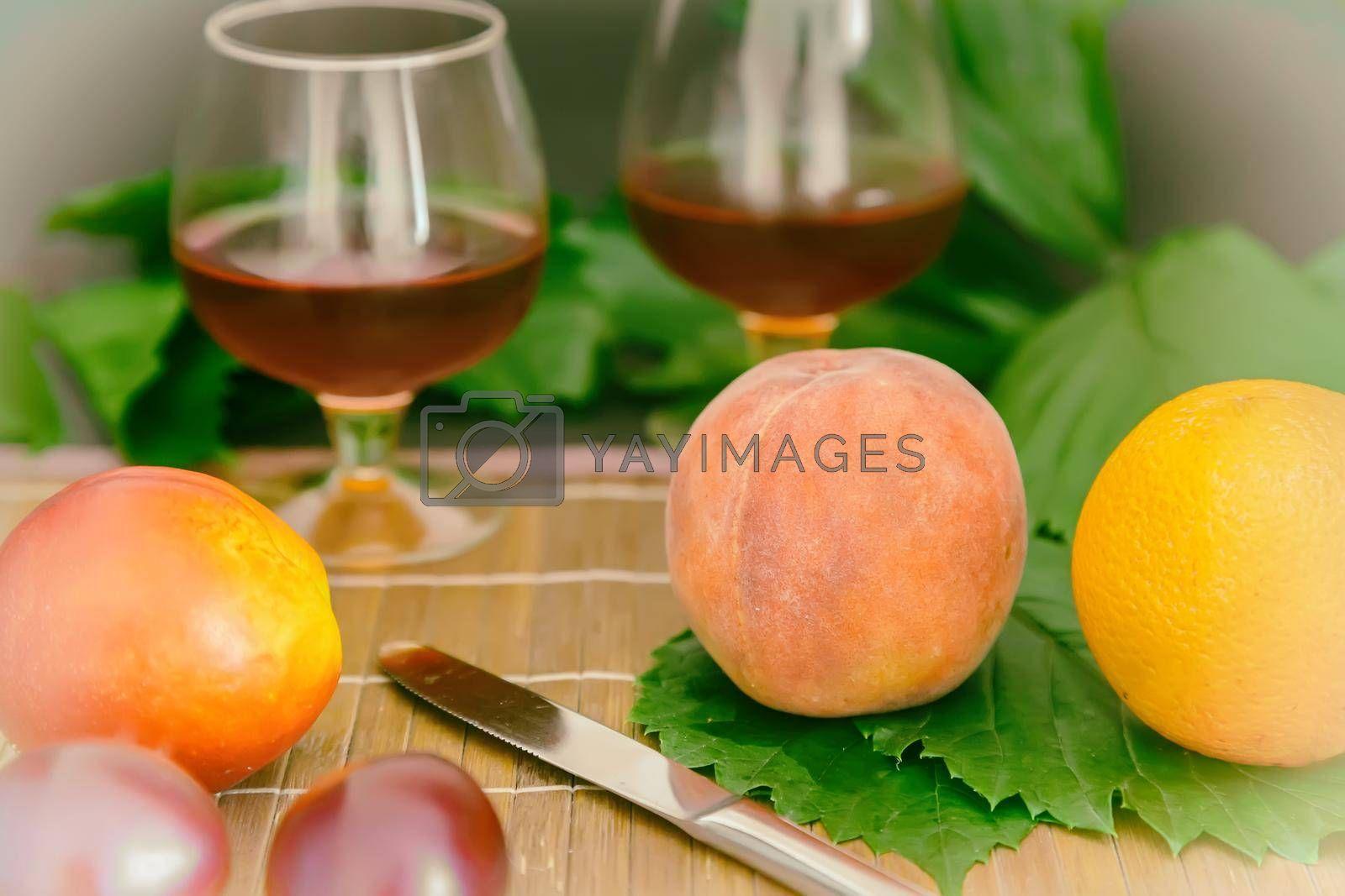 Royalty free image of Still life: wine by the glass and fruit. by georgina198