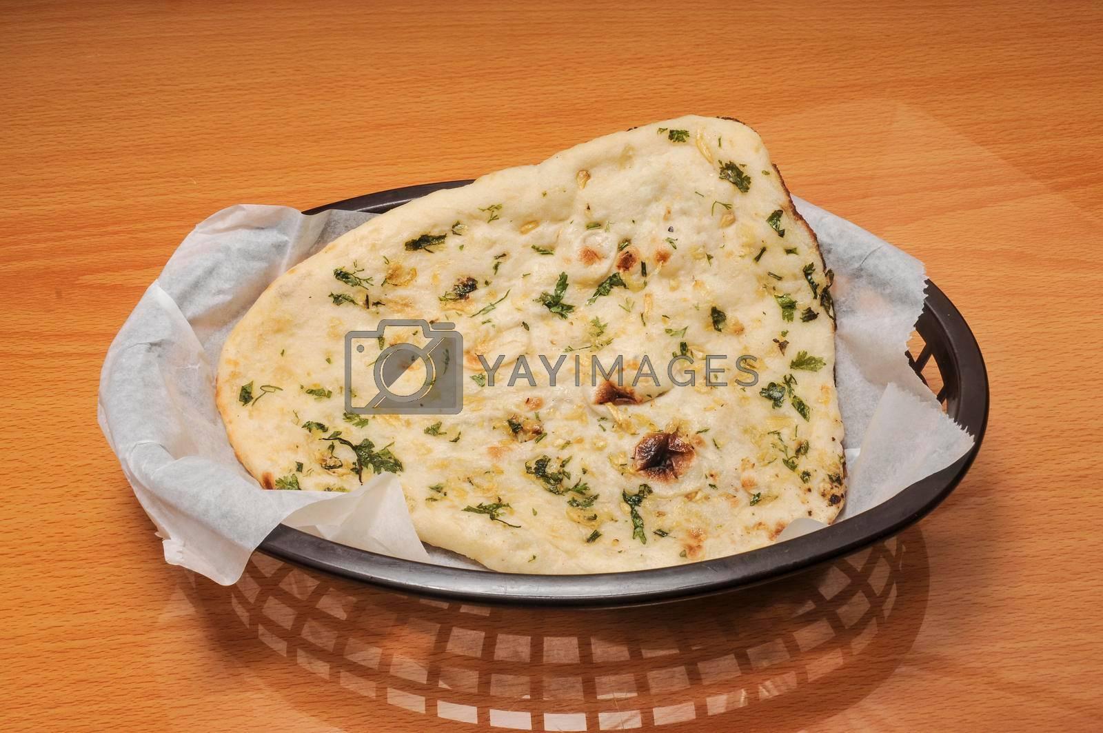 Royalty free image of Delicioius Indian Garlic Naan by robeo