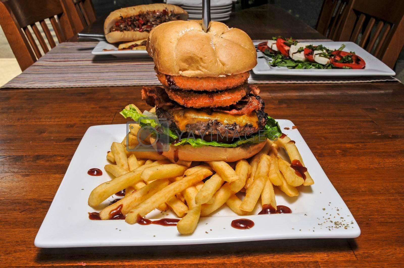 Delicious cheeseburger known as an onion ring cowboy burger