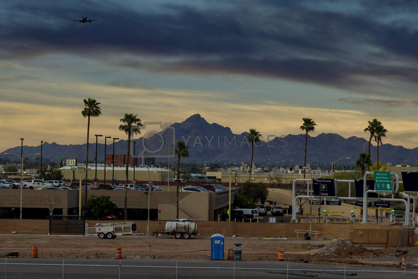 05.Apryl 2021 Phoenix, Arizona USA: Modern international airport during sunset a passenger plane in flight away in to sky on Sky Harbor airport with Phoenix, Arizona USA