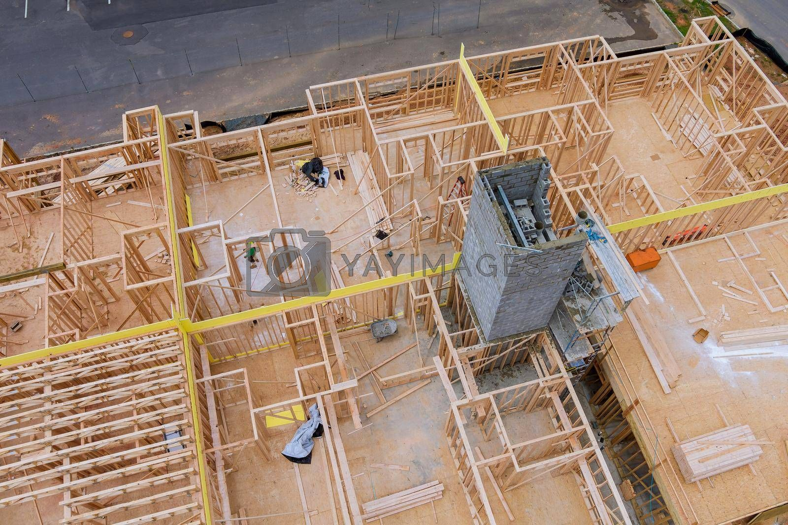 Aerial view of exterior unfinished a house residential construction wall on framing against