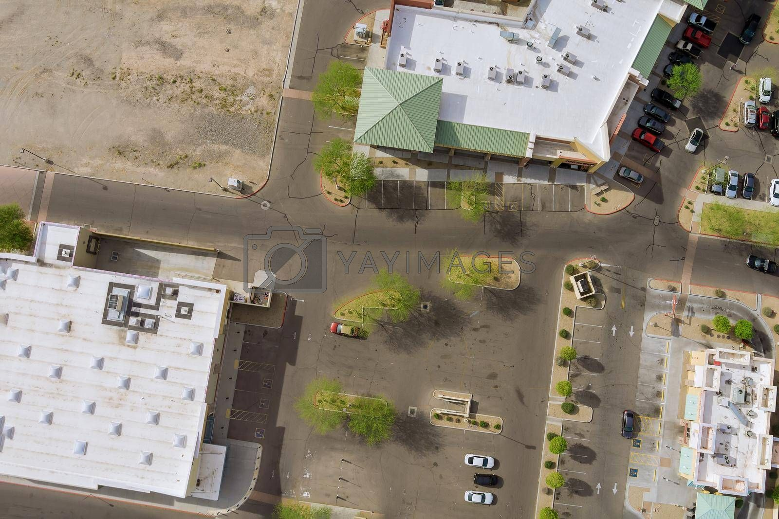 Aerial top view of typical a small town shopping center with big parking lot a US