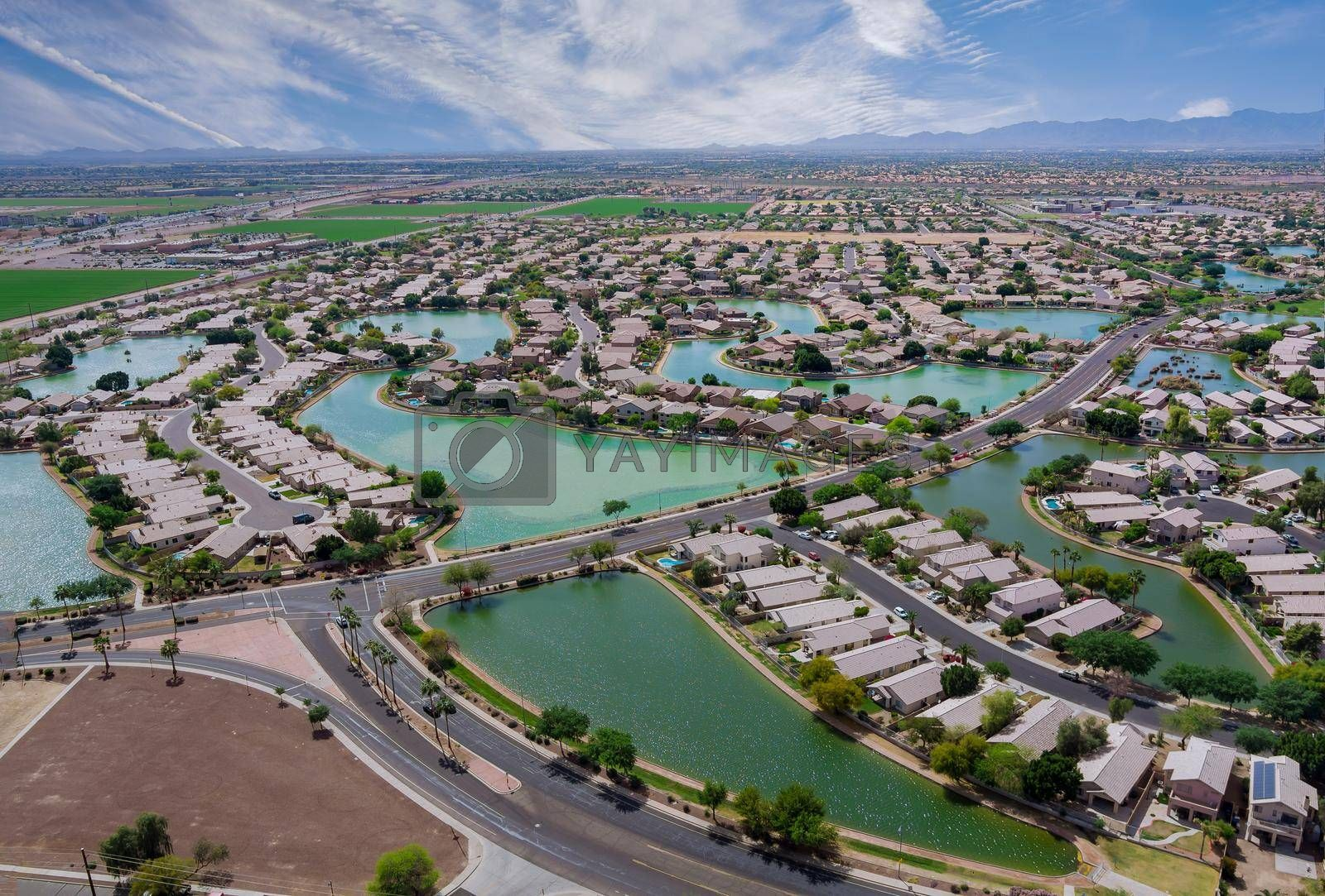 Aerial roofs of the many small ponds near a Avondale town houses in the urban landscape of a small sleeping area Phoenix Arizona USA
