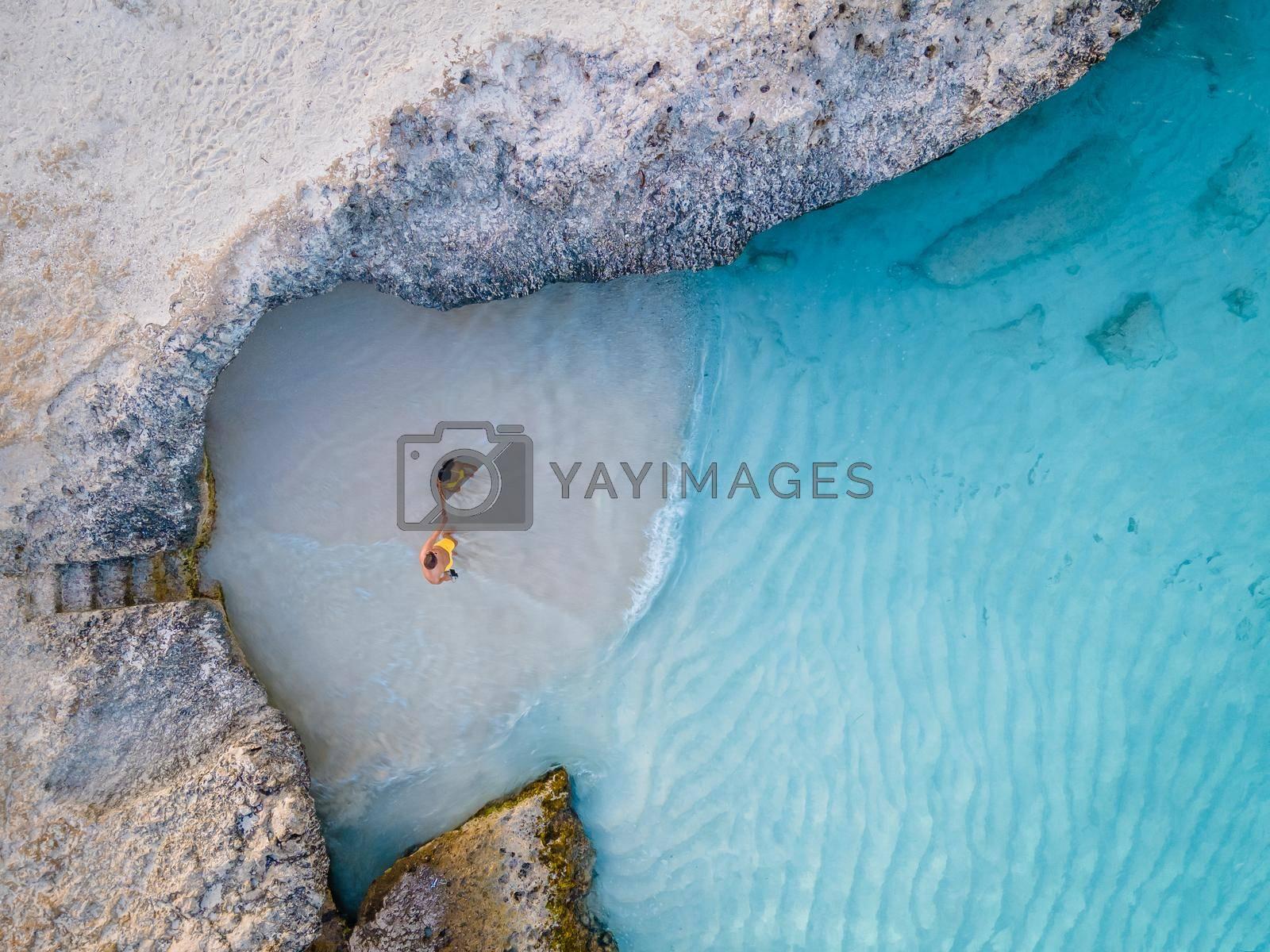 Tres Trapi Steps Triple Steps Beach, Aruba completely empty, Popular beach among locals and tourists, crystal clear ocean Aruba. Caribbean, couple man and woman in a crystal clear ocean