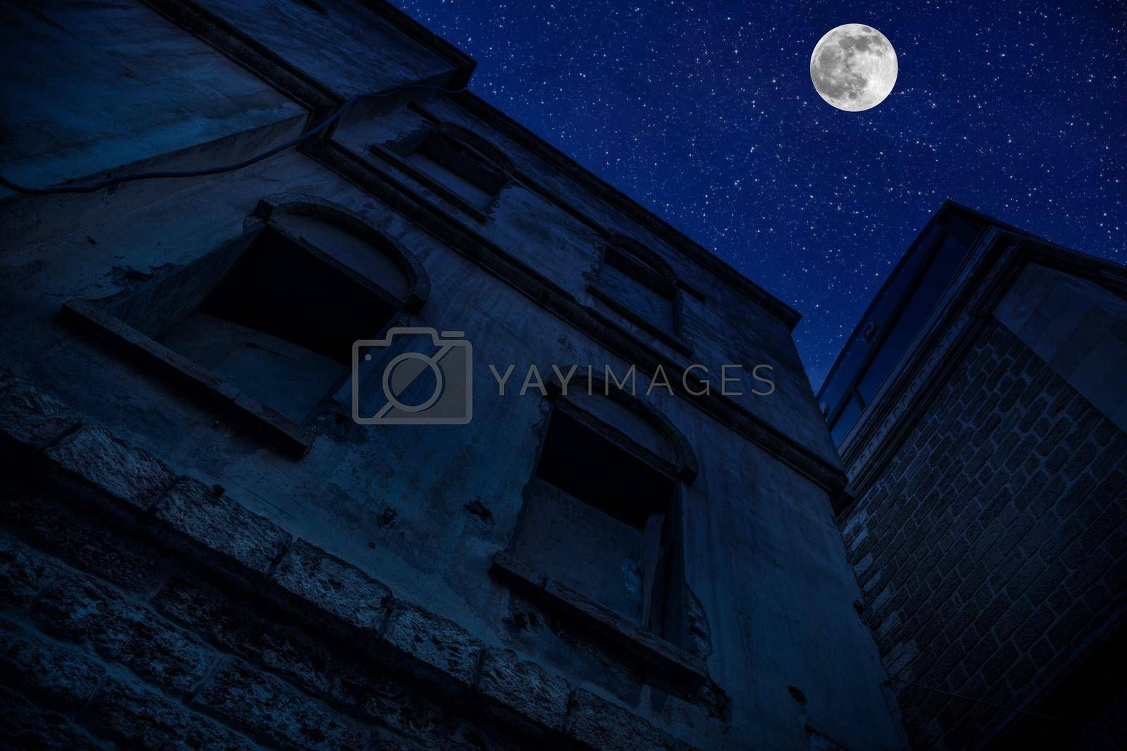 Old city streets at night. Full moon over the city at night, Baku Azerbaijan. Big full moon shining bright over buildings