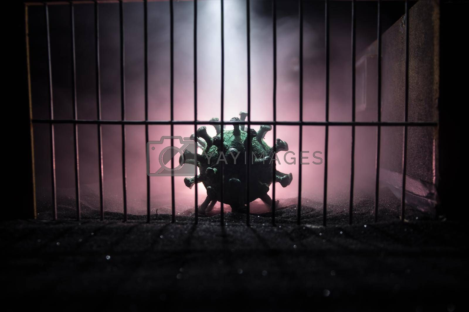 Corona virus lockdown creative concept. Corona virus novel miniature trapped inside old prison. Creative artwork decoration. Selective focus