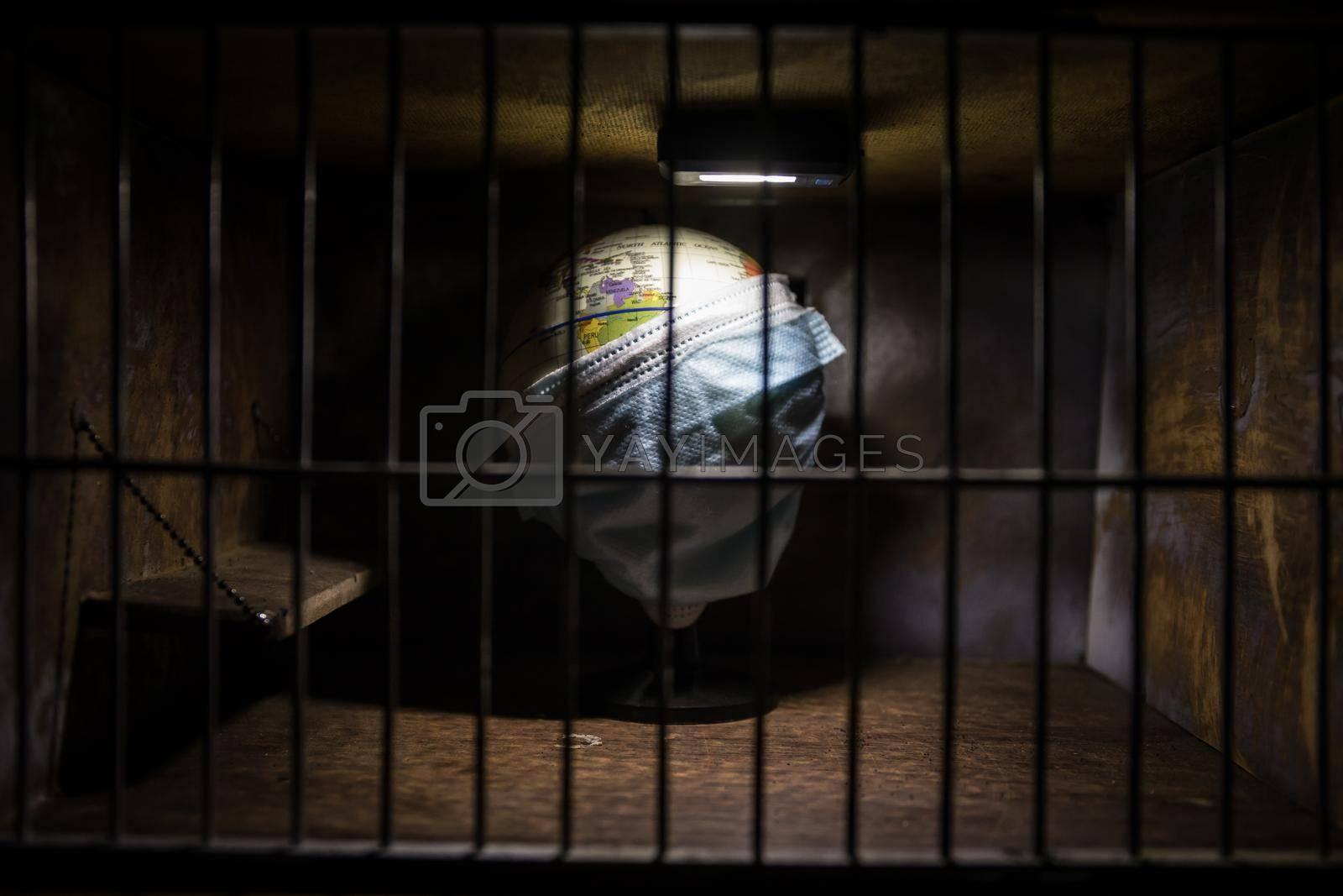 Corona virus lockdown creative concept. Planet earth trapped inside old prison. Creative artwork decoration. Selective focus