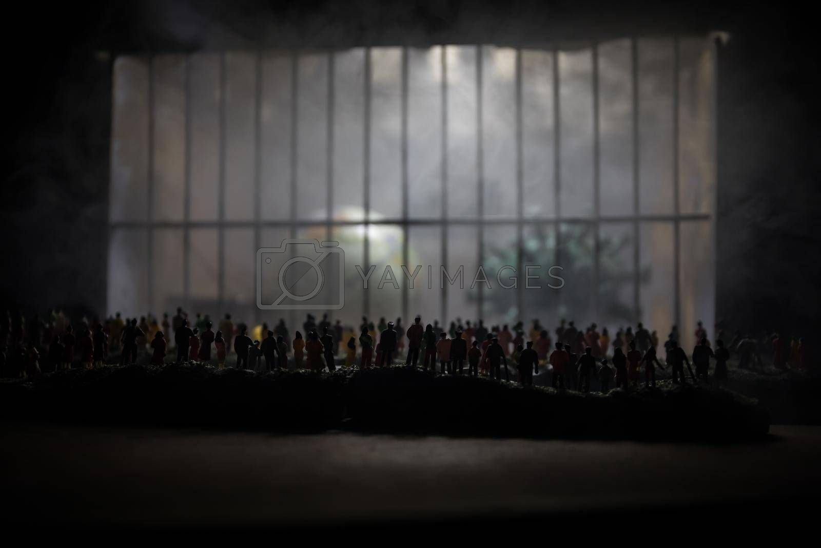 Corona virus lockdown creative concept. Crowd looking on Planet earth trapped inside old prison. Creative artwork decoration. Selective focus