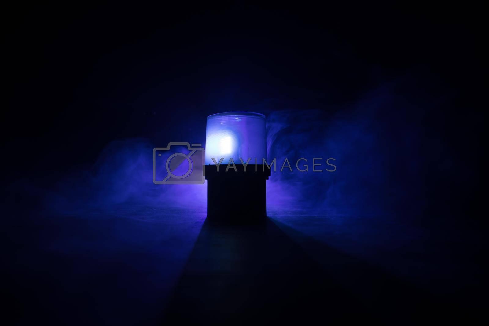 Police car blue round vintage siren in dark. Rotating retro style police siren. Selective focus