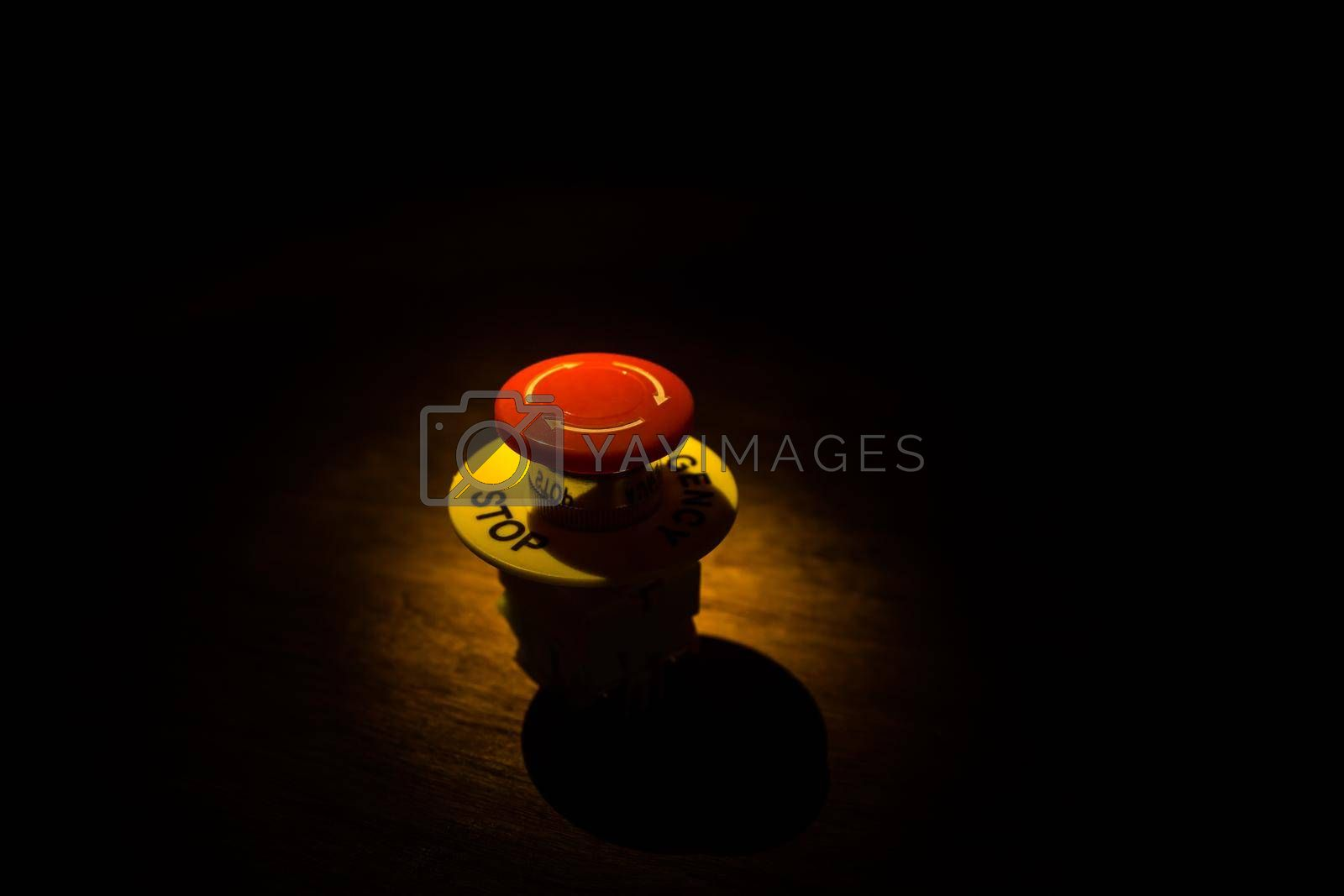 Emergency stop button, Disaster protection. Industrial concept. Red button on table in dark low key background. Selective focus
