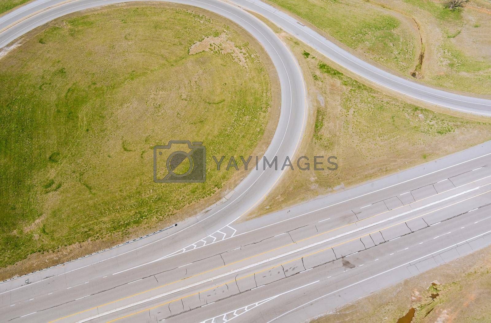Aerial top view of highway junction road in urban populated area America