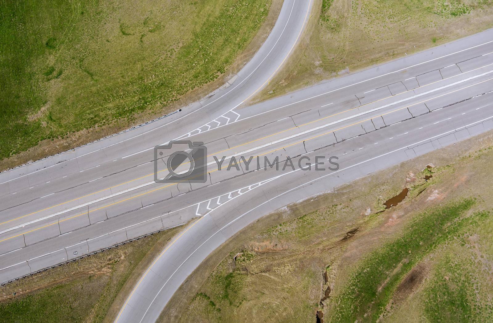 Aerial view road junction interchange highway in the summer