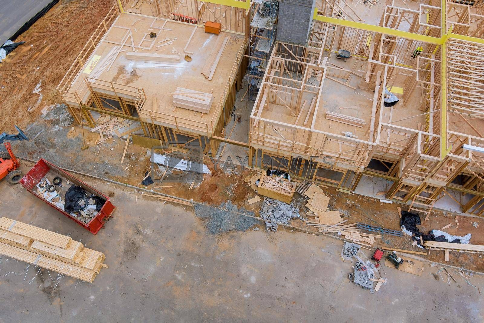 Aerial view of big construction garbage trash refuse dump on stacker wooden material boards and beams for new house on of under construction