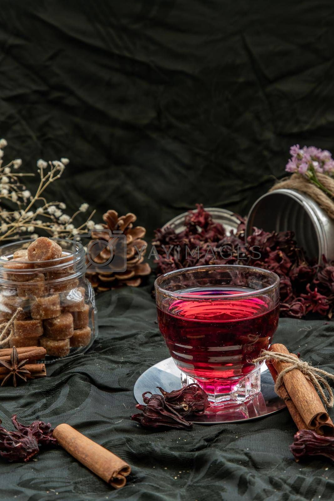 Royalty free image of Roselle tea (Jamaica sorrel, Rozelle or hibiscus sabdariffa ) with dry roselle and brown cane sugar cube.  by tosirikul