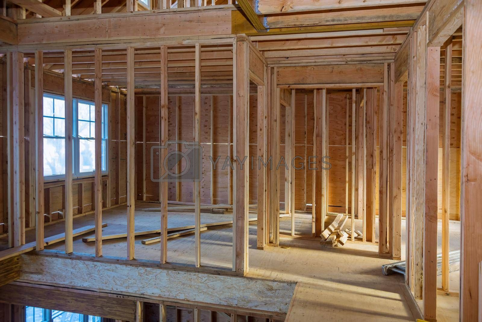 Interior wood framework beam construction of new residential home under construction