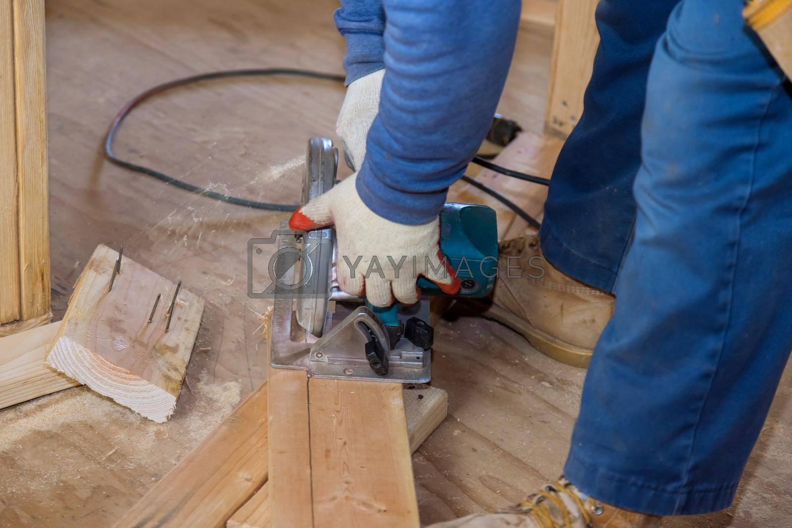 Close Up process cutting of hand circular saw at wood beam cuts on a house renovation.
