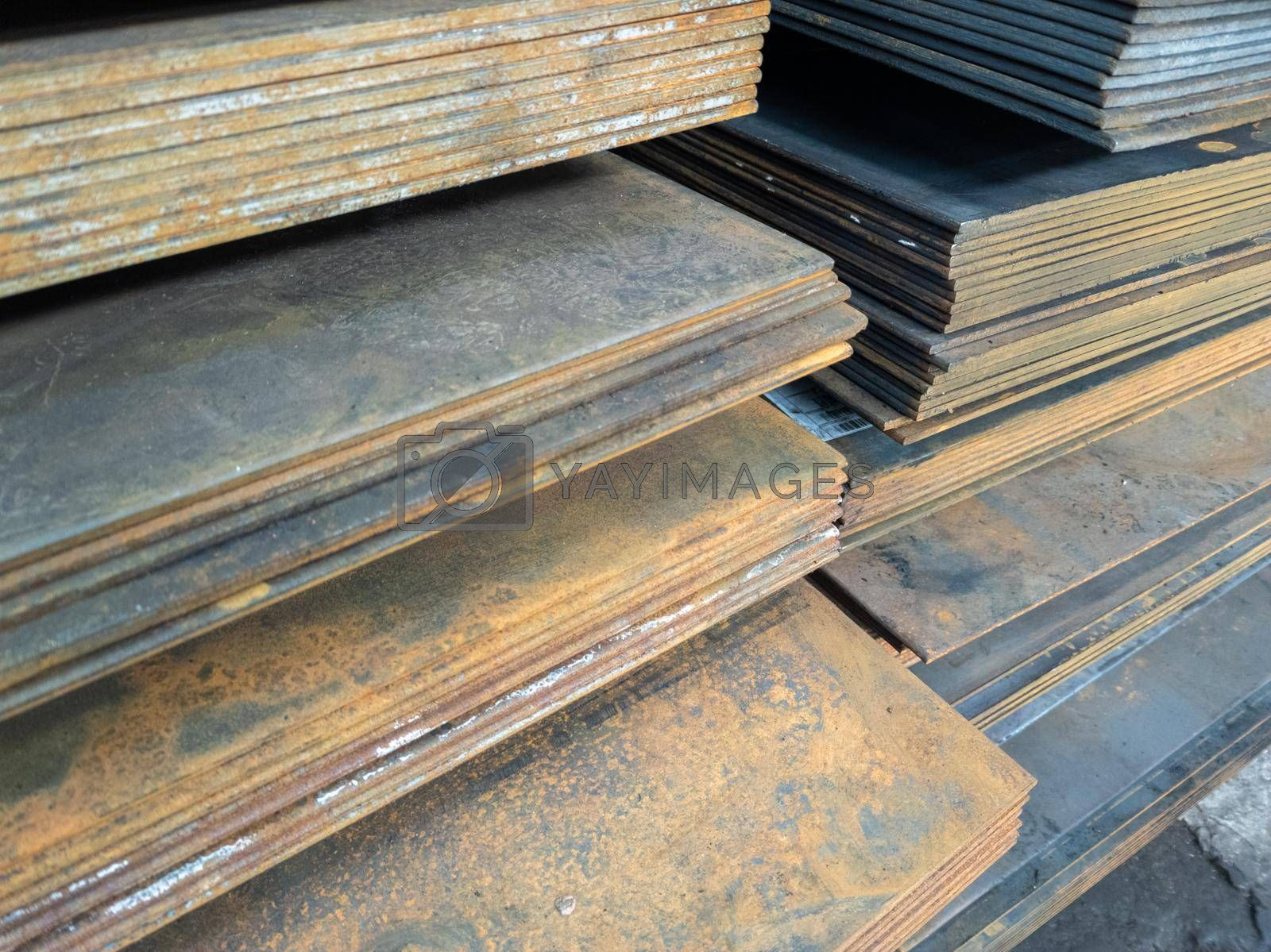stacks of thick rusted flat metal sheets - close-up with selective focus